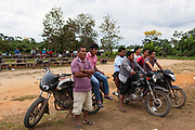 Daily life, a group of men watch a soccer game in Boca Colorado, Peru. Boca Colorado is a town formed entirely by mining activity in the Peruvian Amazon.
