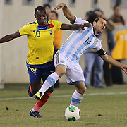 Javier Mascherano, (right), Argentina, is challenged by Walter Ayovi, Ecuador, during the Argentina Vs Ecuador International friendly football match at MetLife Stadium, New Jersey. USA. 15th November 2013. Photo Tim Clayton