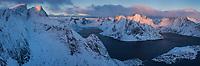 Winter view over Kirkefjord in low january light from Reinebringen, Moskenesøy, Lofoten Islands, Norway