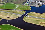 Nederland, Friesland, Waldwei, 01-05-2013; Aquaduct Langdeel. Het aquaduct ligt ten zuiden van Leeuwarden bij de wijk Zuiderburen en maakt deel uit van de Waldwei (N31). Het kanaal Langdeel is onderdeel van de staande mastroute.<br /> Aqueduct Langdeel near Leeuwarden, North Netherlands, next to the newly constructed residential area Zuiderburen (Southern neighbours). It crosses the motorway N31. <br /> luchtfoto (toeslag op standard tarieven);<br /> aerial photo (additional fee required);<br /> copyright foto/photo Siebe Swart motorway N31. <br /> luchtfoto (toeslag op standard tarieven);<br /> aerial photo (additional fee required);<br /> copyright foto/photo Siebe Swart motorway N31. <br /> luchtfoto (toeslag op standard tarieven);<br /> aerial photo (additional fee required);<br /> copyright foto/photo Siebe Swart