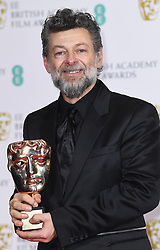Andy Serkis with his award for Outstanding British Contribution to Cinema at the 73rd British Academy Film Awards held at the Royal Albert Hall, London.. Photo credit should read: Doug Peters/EMPICS