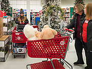 "28 NOVEMBER 2019 - ANKENY, IOWA: Shoppers in the Target store in Ankeny, Iowa, Thursday evening. ""Black Friday"" is the unofficial start of the Christmas holiday shopping season and has traditionally thought to be one of the busiest shopping days of the year. Brick and mortar retailers, like Target, are facing increased pressure from online retailers this year. Many retailers have started opening on Thanksgiving Day. Target stores across the country opened at 5PM on Thanksgiving to attract shoppers with early ""Black Friday"" specials.    PHOTO BY JACK KURTZ"