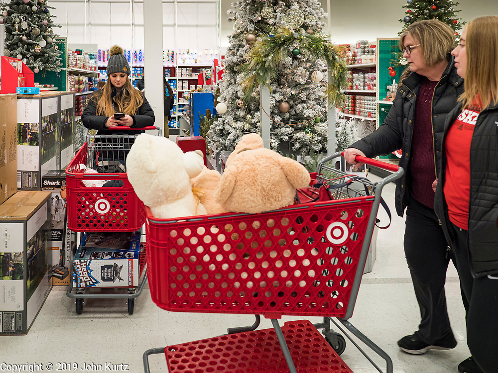 """28 NOVEMBER 2019 - ANKENY, IOWA: Shoppers in the Target store in Ankeny, Iowa, Thursday evening. """"Black Friday"""" is the unofficial start of the Christmas holiday shopping season and has traditionally thought to be one of the busiest shopping days of the year. Brick and mortar retailers, like Target, are facing increased pressure from online retailers this year. Many retailers have started opening on Thanksgiving Day. Target stores across the country opened at 5PM on Thanksgiving to attract shoppers with early """"Black Friday"""" specials.    PHOTO BY JACK KURTZ"""