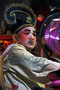 Lao Sa Jia Soon Chinese Opera troupe perform at a shrine in the Talat Noi district of Bangkok, during the Vegetarian Festival 2020