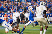 Dec 1, 2012; Tulsa, Ok, USA; Tulsa Hurricanes punter Cole Way (28) holds the ball for place kicker Daniel Schwarz (3) during a game at Skelly Field at H.A. Chapman Stadium. Tulsa defeated UCF 33-27 in overtime to win the CUSA Championship. Mandatory Credit: Beth Hall-USA TODAY Sports