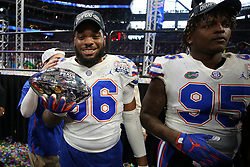 Florida Gators defensive lineman Cece Jefferson #96 celebrates winning the Chick-fil-A Peach Bowl, Saturday, December 29, 2018, in Atlanta. (Jason Parkhurst via Abell Images for Chick-fil-A Peach Bowl)