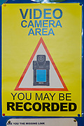 A warning sign reminding people that they are in a video camera area and they might be recorded inside HMP Featherstone, Wolverhampton, Staffordshire United Kingdom. HMP Featherstone is a Category C adult male training prison with a population of around 700 and operated by HM Prison Services. (Picture credit: © Andy Aitchison)