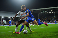 Cardiff City midfielder Rubin Colwill  (27) battles for possession with Fulham defender Denis Odoi  (4)  during the EFL Sky Bet Championship match between Fulham and Cardiff City at Craven Cottage, London, England on 20 October 2021.