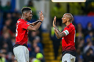 Goal Manchester United Midfielder Paul Pogba (6) celebrates with Manchester United Midfielder Ashley Young (18) during the The FA Cup match between Chelsea and Manchester United at Stamford Bridge, London, England on 18 February 2019.
