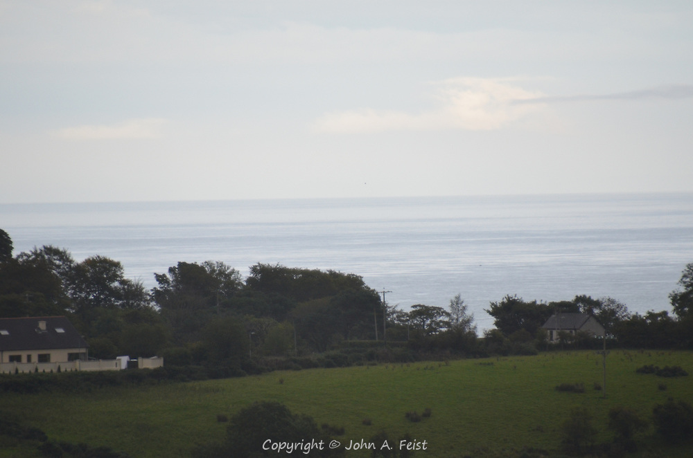 A view to the ocean from Cushendall, County Antrim, Northern Ireland.  The land seems to just roll into the sea.
