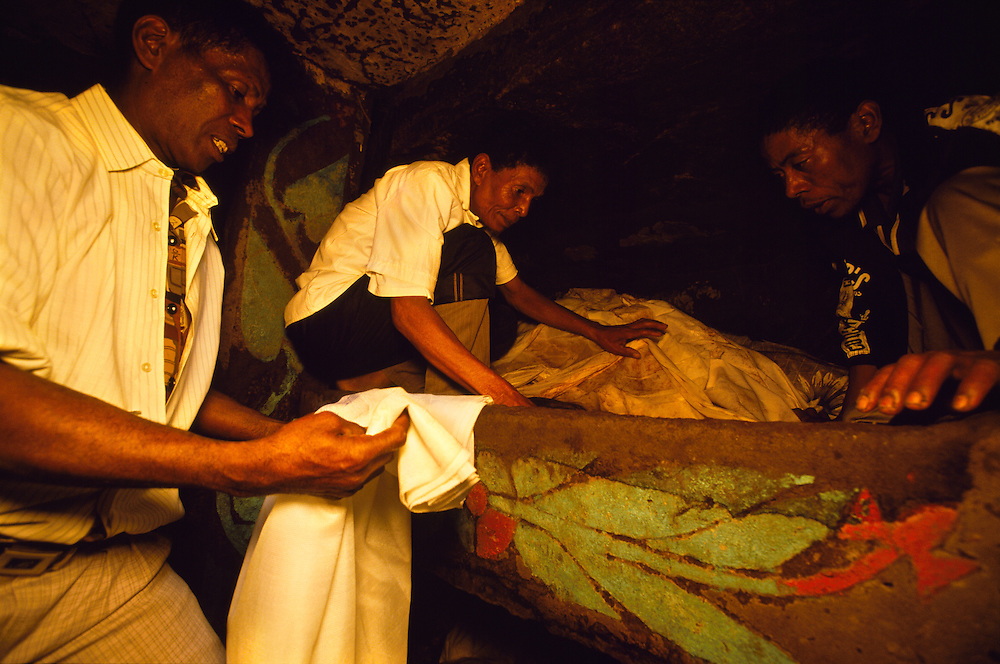 The male members of the family enter the grave and wrap the remains of the dead in new shrouds during a reburial ceremony in Belaveno, Bezanozano Ethnic Area, Madagascar. The famadihana, the Madagascan reburial ceremony, is a custom in the highlands of Madagascar. The purpose of the ritual is to induce the ancestors to impart their blessings to their descendants, as without those blessings one cannot have a good life. The famadihana is held during the cooler half of the year, when the dead are said to be freezing in their graves and therefore need new clothing.
