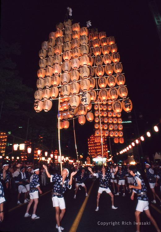 Festival participants balance lighted paper lanterns during the annual Kanto matsuri (festival), Akita city, Akita Prefecture, Japan