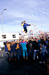 Alaska: Winter in Alaska.  Photo akwint104.  Eskimo Blanket Toss at Fur Rendezvous..Photo copyright Lee Foster, 510/549-2202,  lee@fostertravel.com, www.fostertravel.com