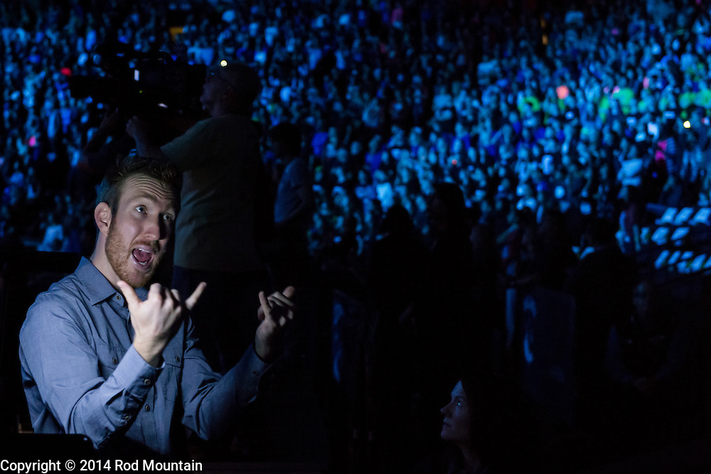 A sign language interpreter communicates to deaf students at Rogers Arena during We Day Vancouver 2014. We Day is about youth coming together to make a difference. We Day, Free The Children, Me to We and We Act make up the global platform for social change that began with brothers Craig and Marc Kielburger. Photo: © 2014 Rod Mountain