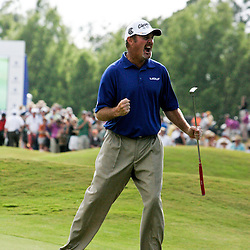 2009 April 26: PGA Tour golf pro Jerry Kelly celebrates after sinking a putt on the 18th green to win in the final round of the Zurich Classic of New Orleans PGA Tour golf tournament played at TPC Louisiana in Avondale, Louisiana.