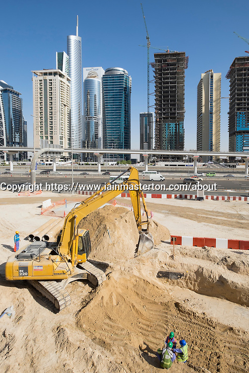 Skyline of Jumeirah Lakes Towers (JLT) and Sheikh Zayed Road with construction site in Dubai United Arab Emirates