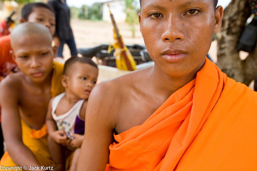 02 JULY 2006 - UDONG, CAMBODIA: Previously ordained novice monks at a ceremony to mark young men and boys becoming monks at a small monastery near Udong, Cambodia. Photo by Jack Kurtz / ZUMA Press