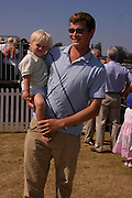 Jack Kidd. Veuve Clicquot Gold Cup Final at Cowdray Park. Midhurst. 17 July 2005. ONE TIME USE ONLY - DO NOT ARCHIVE  © Copyright Photograph by Dafydd Jones 66 Stockwell Park Rd. London SW9 0DA Tel 020 7733 0108 www.dafjones.com