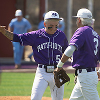 Miyamura pitcher Marc Rios, left, is congratulated by second baseman Sean Matthew Garcia after a strikeout to end the inning Tuesday morning in Gallup against Goddard.