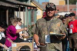 Alex Trepanier enjoying a great hosted dinner in historic downtown Dodge City, KS during the Motorcycle Cannonball Race of the Century. Stage-8 from Wichita, KS to Dodge City, KS. USA. Saturday September 17, 2016. Photography ©2016 Michael Lichter.