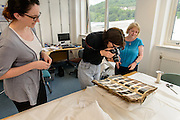 Artist Kate Scardifield during her research visit to the Scottish Borders,  as part of the 'Archival Enactments – New Constellations' project. This first part of her vsist took place between  27th June-  1st July and she visited various archives, artiists, textile facilities, creatives and museums. <br /> At Heriot Watt University she viewed parts of the Textile Collection with Helen Taylor, Archivist. Items views included historic festival banners and local Tweed and tarten samples.<br /> <br /> Kate Scardifield is an interdisciplinary artist living and working in Sydney. Her practice can be likened to a process of anatomical enquiry; mining history for intersecting systems and patterns that culminate in re-imaginings of the body, site and space. Scardifield's works traverse sculpture, installation, textiles, video and painting, often incorporating repetitious iconography and labour intensive techniques. Relationships between the spectacle, the macabre and the divine, in their broadest form, operate as cornerstones in her practice