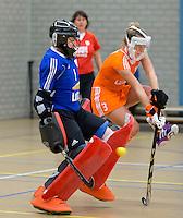 UTRECHT - Keeper Adinda Boeren met Lieke Hulsen (r)  tijdens oefenwedstrijd van het Nederlands dames zaalhockeyteam tegen Australie. COPYRIGHT KOEN SUYK