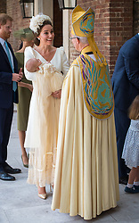 The Duchess of Cambridge speaks to Archbishop of Canterbury Justin Welby as she arrives carrying Prince Louis for his christening service at the Chapel Royal, St James's Palace, London.