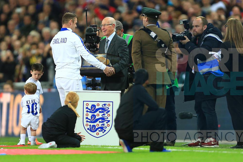Sir Bobby Charlton presents Wayne Rooney of England with his 100th cap - England vs. Slovenia - UEFA Euro 2016 Qualifying - Wembley Stadium - London - 15/11/2014 Pic Philip Oldham/Sportimage
