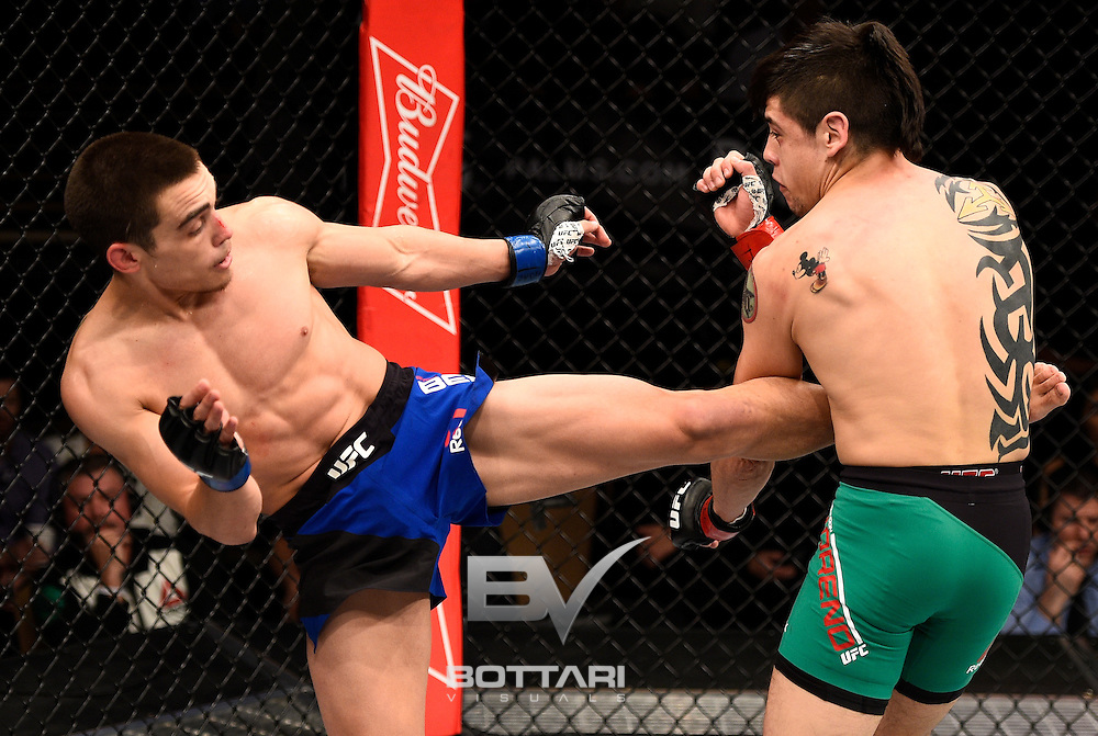 LAS VEGAS, NV - DECEMBER 03:  (L-R) Ryan Benoit kicks Brandon Moreno of Mexico in their flyweight bout during The Ultimate Fighter Finale event inside the Pearl concert theater at the Palms Resort & Casino on December 3, 2016 in Las Vegas, Nevada. (Photo by Jeff Bottari/Zuffa LLC/Zuffa LLC via Getty Images)