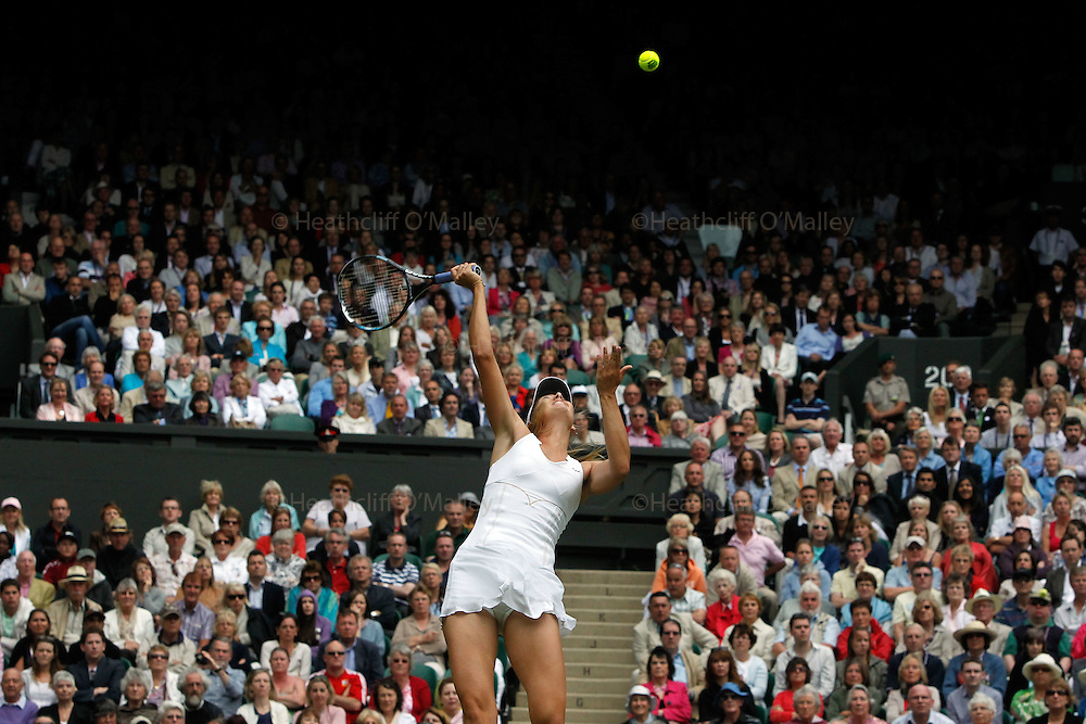 Mcc0032212 . Daily Telegraph..Maria Sharapova was victorious over Sabine Lisicki in two straight sets on Centre Court in the Ladies Singles semi-finals...Maria Sharapova vs Sabine Lisicki..The Tenth day of The Lawn Tennis Championships at Wimbledon..London 30 June 2011