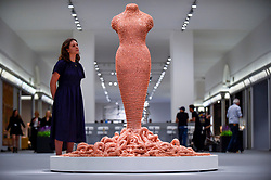"""© Licensed to London News Pictures. 25/06/2019. LONDON, UK. A staff member views """"Medusa"""", 2014-2015, by Susie MacMurray from Pangolin London gallery for the Sculpture Series at a preview of Masterpiece London 2019, the world's leading cross-collecting art fair held in the grounds of the Royal Hospital Chelsea.  The fair brings together 157 international exhibitors presenting works from antiquity to the present day and runs 27 June to 3 July 2019.  Photo credit: Stephen Chung/LNP"""