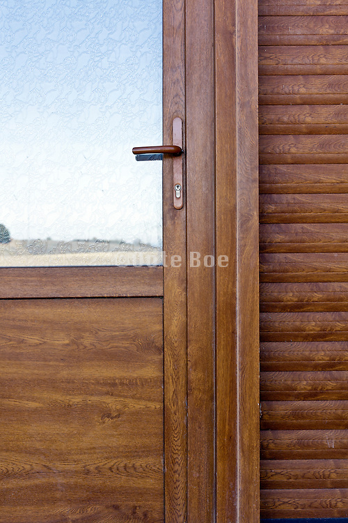 detail of door with rural andscape reflection in the window