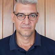 """Mexico City, Mexico, August 16, 2018. The Mexican writer Emiliano Monge portrayed in his home in the Coyoacán neighborhood. Emiliano Monge was born in Mexico City in 1978. He is a political scientist and writer. He has published the books of short stories """"Arrastrar esa sombra"""" (Sexto Piso 2008), short-listed for the Antonin Artaud Prize and """"La superficie más honda"""" (2017); the novels """"El cielo árido"""" (2012), """"Las tierras arrasadas"""" (2015), winner of the Elena Poniatowska Iberoamerican Novel Prize, and """"No contar todo"""" (Literatura Random House 2018), as well as the children book """"Los insectos invisibles"""" (2013).  <br /><br />Città del Messico, Messico, 16 Agosto 2018. Lo scrittore Messicano Emiliano Monge ritratto nella sua casa nel quartiere di Coyoacán. Emiliano Monge è nato a Città del Messico nel 1978. E' stato editore e giornalista e si occupa di scienze politiche e scrittura. Ha esordito nel 2008 con la raccolta di racconti """"Arrastrar esa sombra"""" (Sexto Piso). Nel 2017 il suo nome è stato incluso dall'Hay Festival nella lista """"Bogotà39"""", una selezione dei trentanove migliori autori latinoamericani non ancora quarantenni. In Italia con La Nuova Frontiera ha pubblicato Morire di memoria (2010), Cielo arido (2012) e Terra bruciata (2017), il quale si è aggiudicato uno dei più importanti riconoscimenti letterari del Sud America, il premio Elena Poniatowska.<br />No contar Todo del 2018 è stato pubblicato in spagnolo da Literatura Random House."""