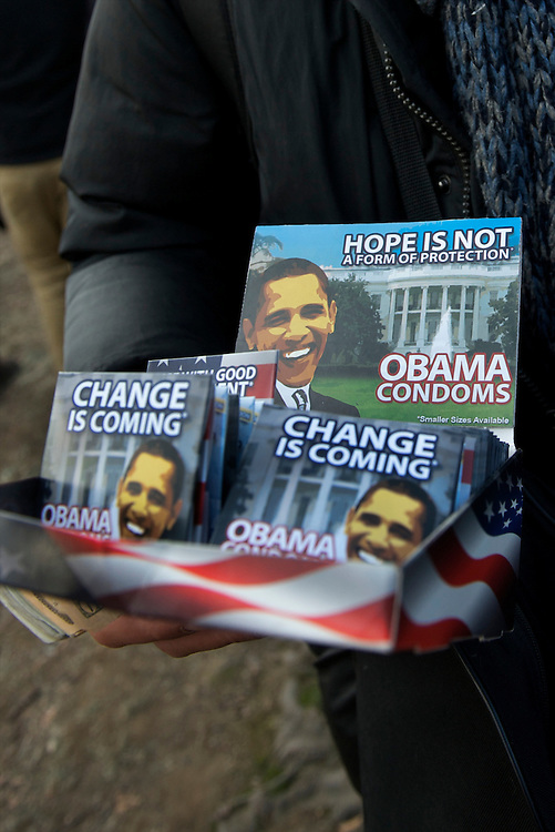 Vendors hawk Barack Obama commemorative condoms on the day of Barack Obama's historic Presidential inauguration.  An estimated two million people flocked to Washington D.C. for the ceremony, enduring freezing temperatures to witness Obama take the oath of office becoming the first African-American to become President, the 44th in the history of the United States of America.