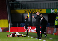 Football - 2020 / 2021 Premier League - Burnley vs. Fulham<br /> <br /> Burnley manager Sean Dyche complains to referee Jonathan Moss after a bad foul on one of his players, at Turf Moor.<br /> <br /> <br /> COLORSPORT/ALAN MARTIN