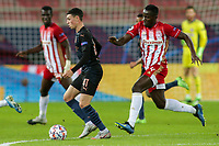 PIRAEUS, GREECE - NOVEMBER 25: Phil Foden of Manchester City attacks in front of Mohamed Camara of Olympiacos FC during the UEFA Champions League Group C stage match between Olympiacos FC and Manchester City at Karaiskakis Stadium on November 25, 2020 in Piraeus, Greece. (Photo by MB Media)