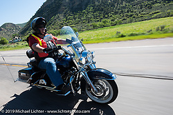 Beau Baggett of the Denver HOG Chapter on his 2013 Road King riding from Steamboat Springs to Doc Holliday's Harley-Davidson in Glenwood Springs during the Rocky Mountain Regional HOG Rally, Colorado, USA. Thursday June 8, 2017. Photography ©2017 Michael Lichter.