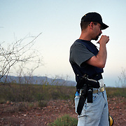 TOMBSTONE, AZ - June 22, 2003:  A volunteer patrols the border near Douglas, Arizona on lookout for undocumented migrants. Led by Chris Simcox, the group stops migrants believed to have crossed illegally into the US and then calls the Border Patrol. (Photo by Todd Bigelow/Aurora) Please contact Todd Bigelow directly with your licensing requests.