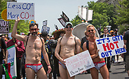 Three friends emphasizing rising temperatures at the Climate March in Washington D.C.
