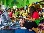 28 NOVEMBER 2017 - YANGON, MYANMAR: A nun talks to a group of women at St. Francis of Assisi Church in Yangon. They are all going to the papal mass Wednesday. About 1,500 people are camping at the church before the papal mass at Kyaikkasan Sports Ground, about three kilometers from the church.    PHOTO BY JACK KURTZ