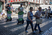 Two pedestrians cross the cobbled Rua Sa da Bandeira, followed closely by a pair of Segway riding tourists, on 21st July, in Porto, Portugal. Segway tours have become controversial additions to the European city sightseeing scene, already being banned in Barcelona and Prague. But in Portuguese cities like Lisbon and Porto, Segway travellers still share narrow and busy streets and often, pavements, with locals on foot. (Photo by Richard Baker / In Pictures via Getty Images)