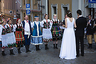 Poznan, Poland - August 29, 2015: A bride and groom on a street in Poznan.