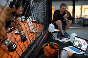 Johny Hendricks studies fight footage of his opponent, Robbie Lawler, during training at Velociti Fitness in Pantego, Texas. on February 26, 2014.