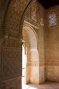 Ornate carving and architecture after conservation work in Court of the Soultana, Alhambra, Granada. Arabesque arches and fine carvings adorn this finely-detailed Moorish architecture - well preserved by Spanish authorities. Alhambra (in Arabic, Al-Ḥamra) is a palace and fortress complex constructed during the mid 14th century by the Moorish rulers of the Emirate of Granada in Al-Andalus, occupying the top of the hill of the Assabica on the south-eastern border of the city of Granada in the Autonomous Community of Andalusia. The Alhambra's Moorish palaces were built for the last Muslim Emirs in Spain and its court, of the Nasrid dynasty.