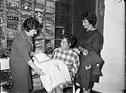 Mrs Pat Moss, the British racing driver's wife, is presented with sweaters..06.04.1961