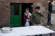 Spme people waits in traditional way pig slaughtering.  Doneztebe (Basque Country). December 08. 2016. The slaughter traditionally takes place in the autum and early winter and the work often is done in the open. (Gari Garaialde / Bostok Photo)