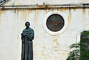 Statue of friar Andrija Kacic-Miosic, in town square Kacicev trg, with church rose window in background. Makarska, Croatia