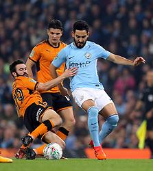 Wolverhampton Wanderers' Jack Price (left) and Manchester City's Ilkay Gundogan battle for the ball