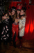 3 sisters: Mary Temperley, Alice Temperley and Matilda Temperley. 21 st Century Burlesque Extravaganza in aid of Amnesty. Canvas. goods Way. Kings Cross. 25 November 2004. ONE TIME USE ONLY - DO NOT ARCHIVE  © Copyright Photograph by Dafydd Jones 66 Stockwell Park Rd. London SW9 0DA Tel 020 7733 0108 www.dafjones.com