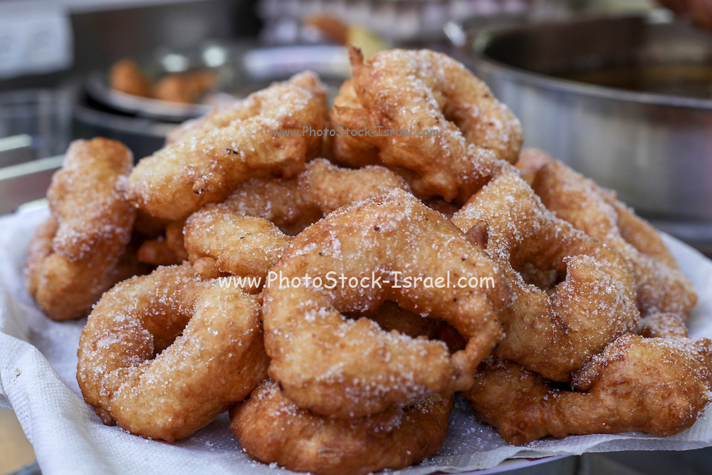 Freshly fried Sfenj a Maghrebi doughnut: a light, spongy ring of dough fried in oil. Sfenj is eaten plain, sprinkled with sugar, or soaked in honey.
